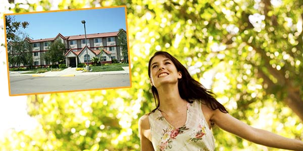 Photo of Rocklin CA Hotel with happy lady in spring